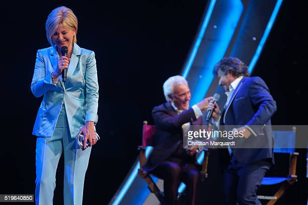 Carmen Nebel Tony Christie and Andy Borg perform on stage during the tv show 'Willkommen bei Carmen Nebel' at Tempodrom on April 7 2016 in Berlin...