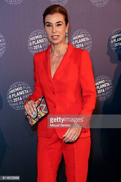 Carmen Posadas poses in a photocall wearing a Purificacion Garcia suit during the '65th Premio Planeta' Literature Award the most valuable literature...