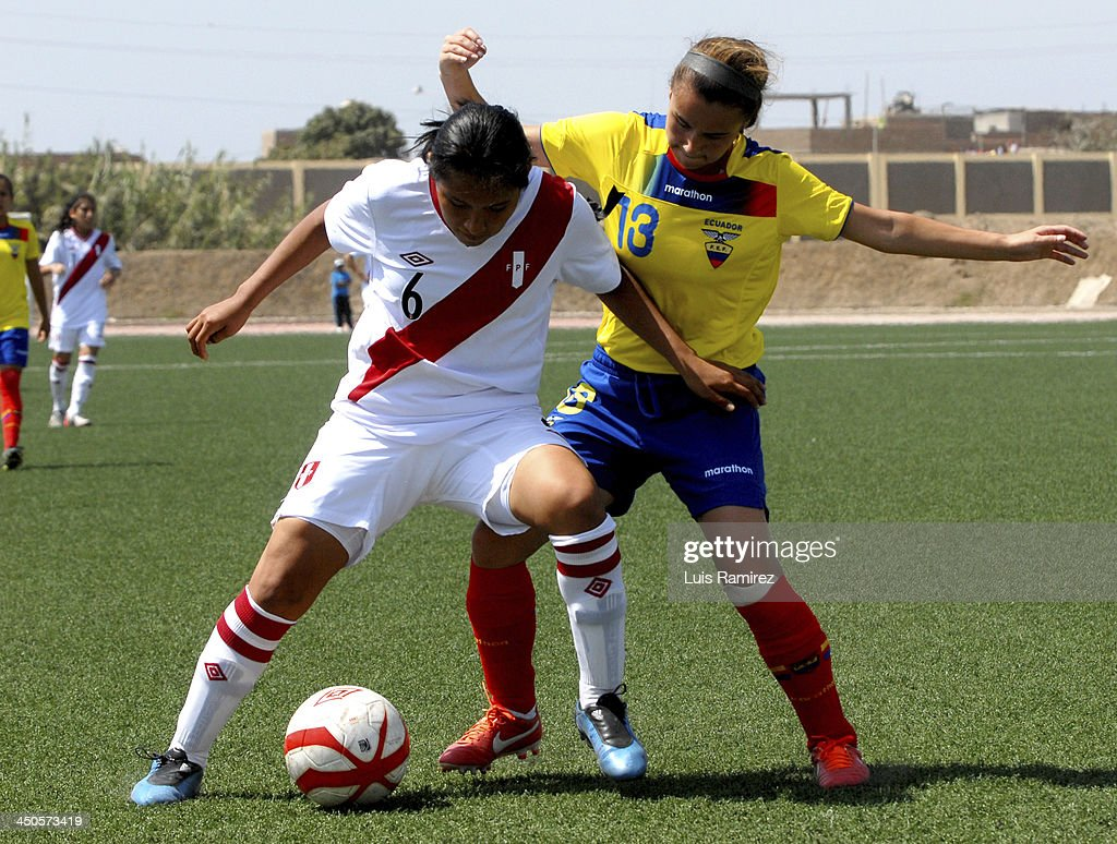 Carmen Quesada of Peru fights for the ball with Alexandra Jean of Ecuador during a match between Peru and Ecuador in Women's U-20 football Qualifiers as part of the XVII Bolivarian Games Trujillo 2013 at Colegio San Jose on November 17, 2013 in Chiclayo, Peru.