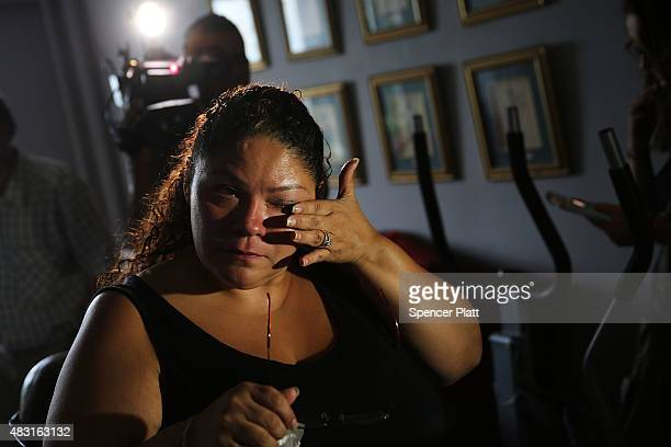 Carmen Ramirez whose father Carmelo Quiles recently died of Legionnaires disease pauses in her mothers apartment in an area of the Bronx which is the...