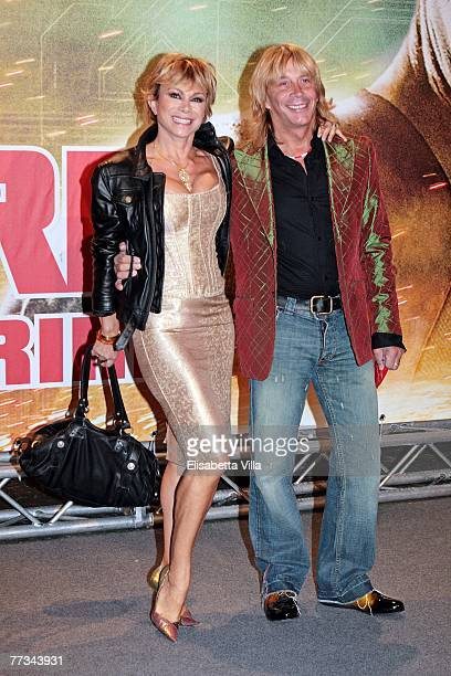 Carmen Russo and Enzo Paolo Turchi attend the Italian premiere of the movie Live Free Or Die Hard at Auditorium Conciliazione October 15 2007 in Rome...