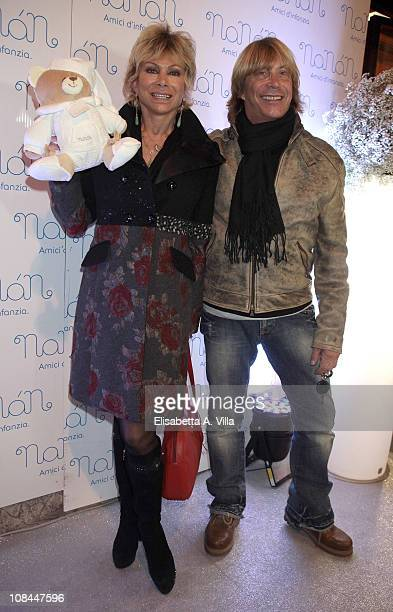 Carmen Russo and Enzo Paolo Turchi attend the Nanan Flagship Store Opening on January 27 2011 in Rome Italy