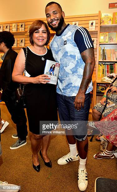 Carmen Surillo and Rapper The Game attend the La La Anthony The Power Playbook book signing at Barnes Noble on May 8 2015 in Atlanta Georgia