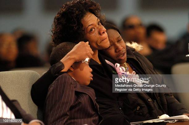 INGLEWOOD Carmen Taylor Jones mother of shooting victim Breon Taylor holds on to her youngest son Barrington Taylor and youngest daughter Bailey...