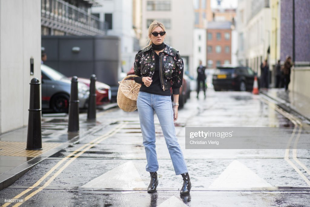 Carmille Charriere wearing straw bag, ankle boots, denim jeans, leather jacket outside Erdem during London Fashion Week September 2017 on September 18, 2017 in London, England.