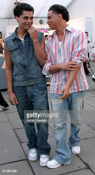 Carmine Gotti and Frank Gotti poses for a picture during the Olympus Fashion Week Spring 2005 at Bryant Park September 9, 2004 in New York City.