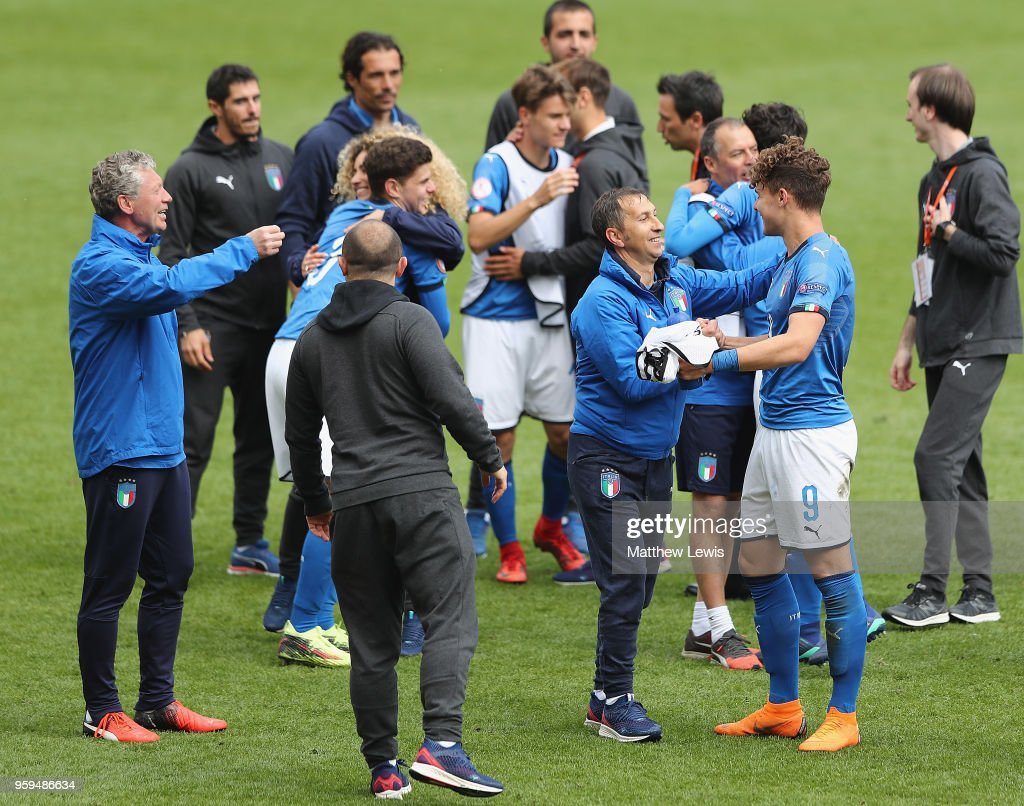Carmine Nunziata, manager of Italy and Edoardo Vergani of Italy celebrate their teams win during the UEFA European Under-17 Championship Semi Final match between Italy and Belgium at the New York Stadium on May 17, 2018 in Rotherham, England.