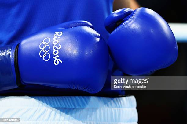 Carmine Tommasone of Italy wears the official gloves for his Men's light weight 60 kg Preliminary bout on Day 1 of the Rio 2016 Olympic Games at...