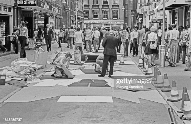 Carnaby Street in London is paved with colourful rubberised paving tiles, UK, 22nd August 1973.
