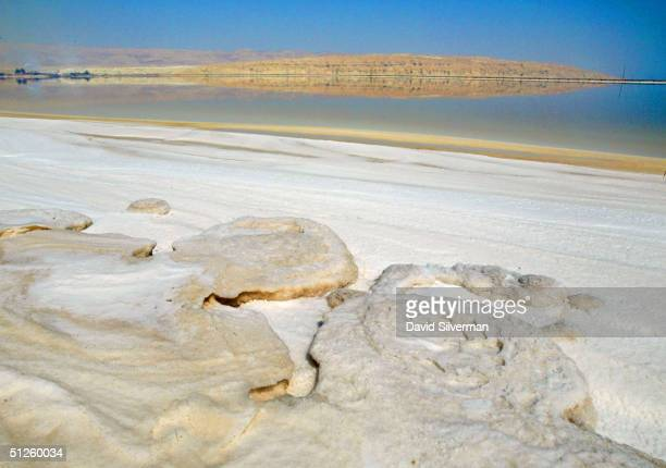 Carnalite crystal formations cover the surface of Dead Sea Works evaporation pools at the industrial giant's potash recovery plant on the shores of...