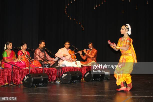 Carnatic musicians accompany a Tamil Bharatnatyam dancer as she performs an expressive dance during her Arangetram in Brampton Ontario Canada The...