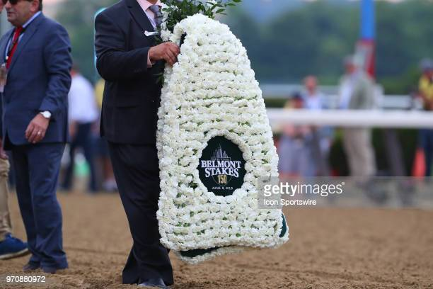 Carnation blanket is readied to be put on Justify after winning the 150th Belmont Stakes and the Triple Crown on June 9 2018 at Belmont Park in...