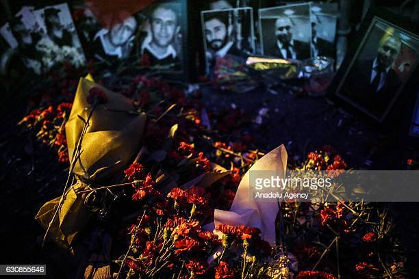 Carnations are placed at site as people take part in a protest against Istanbul nightclub terror attack in Istanbul, Turkey on January 3, 2017. An...