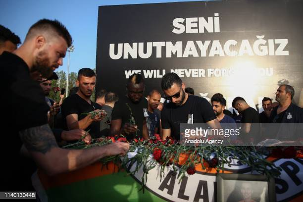 Carnations are placed on the coffin of Czech striker of Turkish football club Alanyaspor Josef Sural during a ceremony at the club facility in...