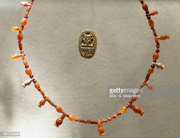 Carnelian necklace and gold ring dedicated to Ramesses II Goldsmith Art Egyptian Civilisation New Kingdom Dynasty XIX Monaco Staatliche Sammlung...