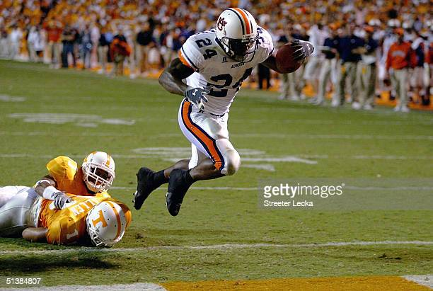 Carnell Williams of the Auburn Tigers scores a touchdown against the Tennessee Volunteers at Neyland Stadium on October 2 2004 in Knoxville Tennessee