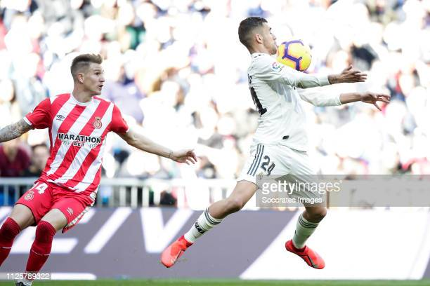 Carnero of Girona Dani Ceballos of Real Madrid during the La Liga Santander match between Real Madrid v Girona at the Santiago Bernabeu on February...