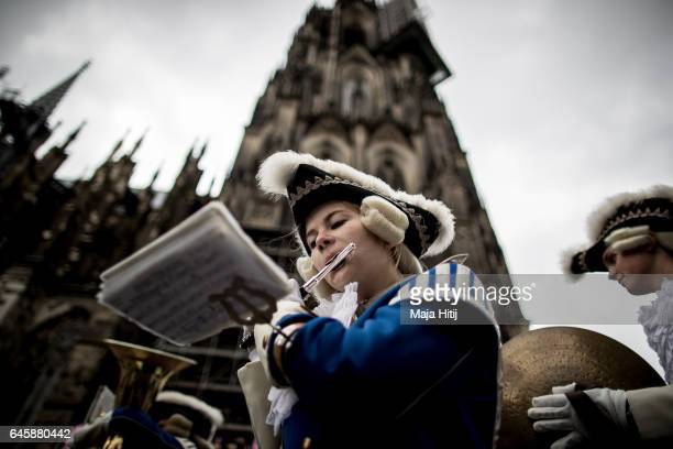 Carneval members attend Rose Monday parade on February 27 2017 in Cologne next to the Cathedral Germany Political satire is a traditional cornerstone...