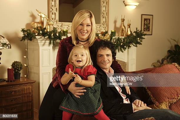 Carnie Wilson daughter Lola and husband Rob Bonfiglio pose for a photo during a portrait shoot at their home on September 14 2007 in Tarzana...