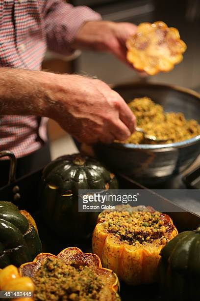 Carnival and acorn squash are stuffed Mohammed Fotouhi prepares dishes for Thanksgiving on Wednesday October 23 2013 From Iran the Fotouhis spice up...