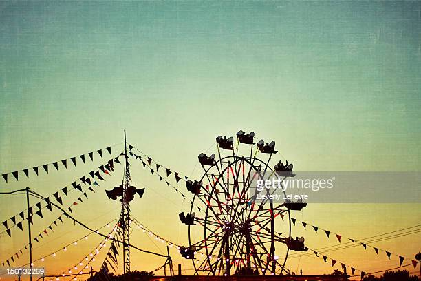 carnival at sunset - traveling carnival stock pictures, royalty-free photos & images