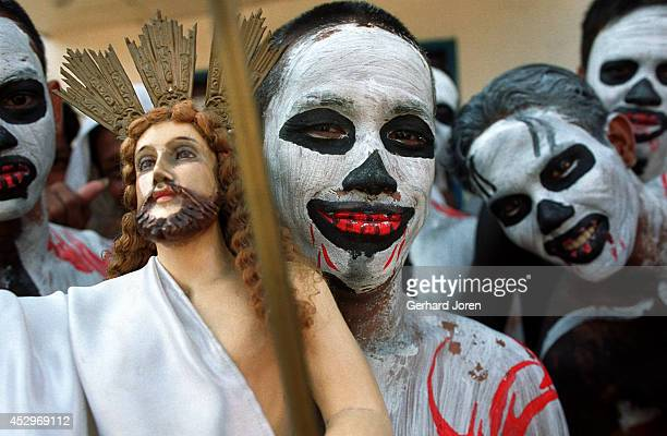 Carnival atmosphere on Easter Sunday at Manila City Jail. Nine juvenile inmates, dressed in death masks, perform to the sound of drums. On Good...