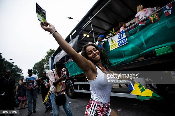 A carnival attendee in costume drinks a beer at the Notting Hill Carnival at Notting Hill on August 30 2015 in London England