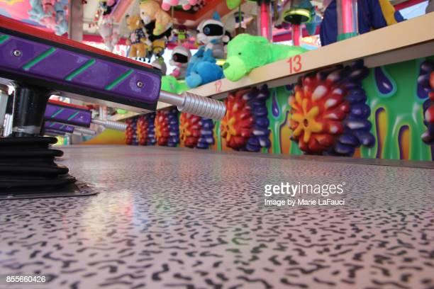 carnival booth squirt gun game with prizes - fauci stock pictures, royalty-free photos & images