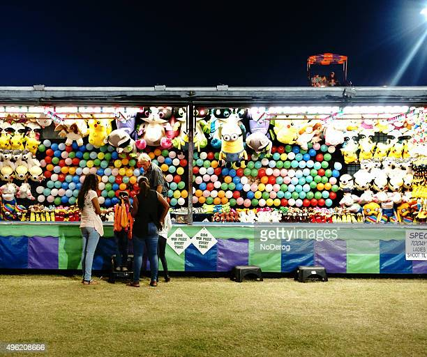 Carnival booth with balloons and stuffed animals