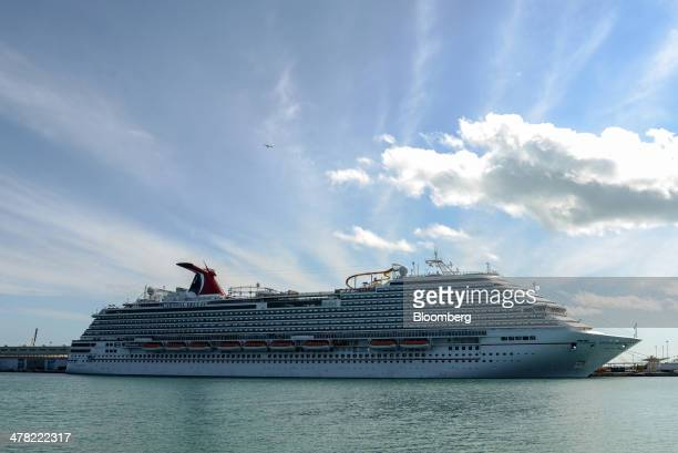 Carnival Corp Plc's Breeze cruise ship stands docked prior to departure at the Port of Miami in Miami Florida US on Sunday March 9 2014 Carnival...