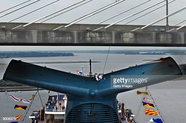 Carnival Cruise Lines first officer Isidoro Renda uses a pole to measure the vertical clearance from the top of the the Dames Point Bridge as the...