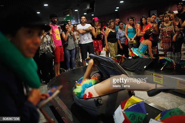 Carnival dancer emerges from a suitcase to surprise people arriving in the baggage claim area at Guararapes Gilberto Freyre International Airport on...