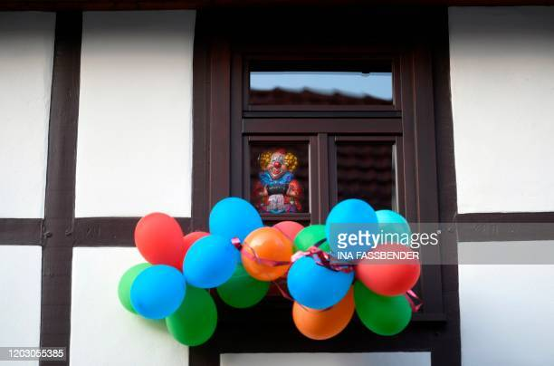 Carnival decoration and balloons are seen at a house in Volkmarsen near Kassel central Germany on February 25 2020 A car that rammed into a carnival...