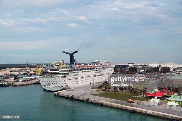 carnival ecstasy docked in freeport, bahamas. aerial view - freeport bahamas stock photos and pictures