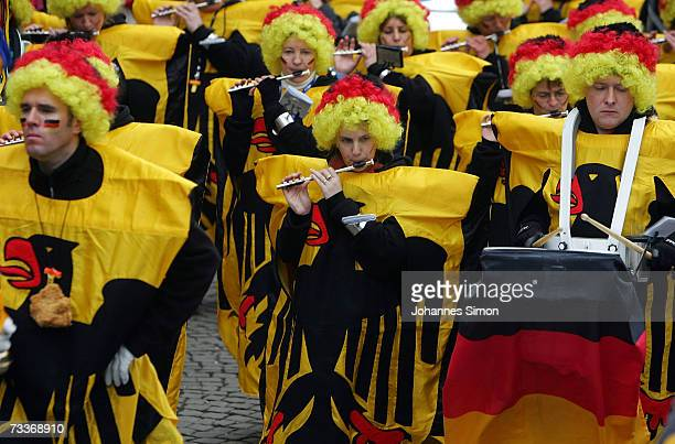 Carnival enthusiasts dressed with German national flags attend the 'Rose Monday' parade February 19 2007 in Cologne Germany Hundreds of thousands...