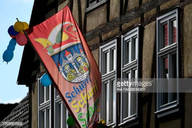 A carnival flag hangs at a house on February 25 2020 in Volkmarsen near Kassel central Germany A car that rammed into a carnival procession in...