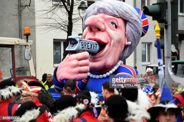 A carnival float depicting British Prime Minister Theresa May pointing a gun to her with the lettering 'Brexit' takes part in the traditional 'Rose...