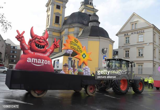 A carnival float depicting the devil and the inscirption 'Death to small retailers Amazon' is seen in DuesseldorfGermany 08 February 2016 A violent...