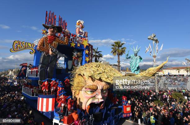 A carnival float entitled 'Bang Bang' with a mask depicting the face of US President Donald Trump rolls through the streets of Viareggio during the...