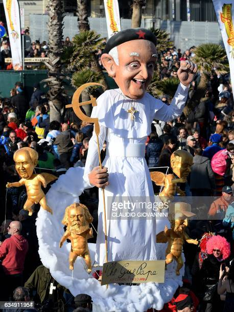 A carnival float entitled 'Che Gue Pop ' rolls through the streets of Viareggio during the traditional carnival in Tuscany on February 12 2017 / AFP...