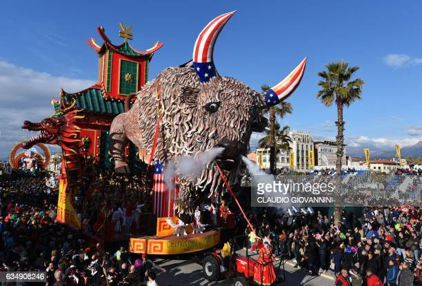 A carnival float entitled 'Chinatown street' rolls through the streets of Viareggio during the traditional carnival in Tuscany on February 12 2017 /...