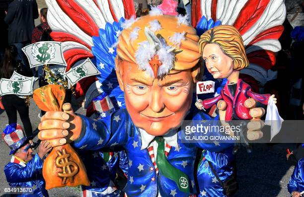 A carnival float entitled 'The harebrained Trump ' depicting US President Donald Trump and former US democratic presidential candidate Hillary...