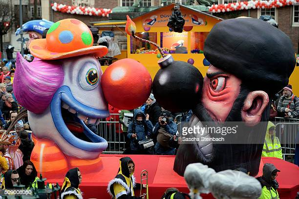 A carnival float featuring a clown facing an Islamic fighter stands on display near city hall on February 8 2016 in Duesseldorf Germany Today's Rose...