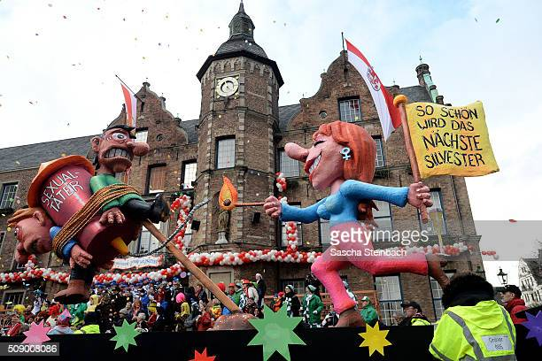 A carnival float featuring a woman lighting up a rocket with two men chained on it alluding to the sexual assaults in New Year's Eve stands on...