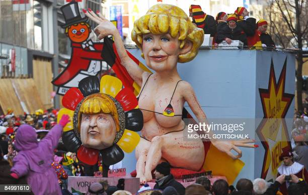 """Carnival float featuring an effigy of German Chancellor Angela Merkel takes part in the """"Rose Monday"""" carnival parade in the western German city of..."""