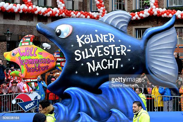 A carnival float featuring one fish eating another alluding to the sexual assaults on New Year's Eve in Cologne stands on display near city hall on...