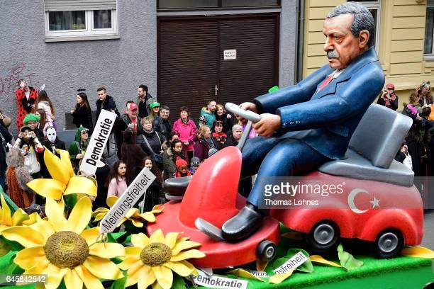 A carnival float featuring the Turkish President Recep Tayyip Erdogan sitting at a mowing machine drives in the annual Rose Monday parade on February...