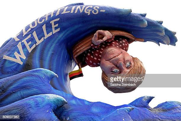 A carnival float mocking German Chancellor Angela Merkel stands on display near city hall on February 8 2016 in Duesseldorf Germany Today's Rose...