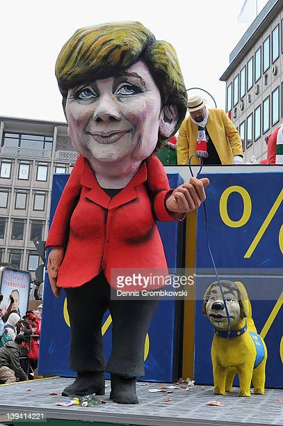 A carnival float showing german chancellor Angela Merkel with Philipp Roesler of german Free Democratic Party as her puppy accompanies in the Rose...