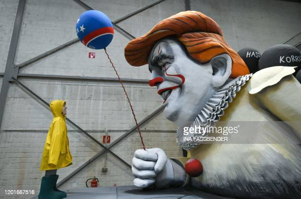 TOPSHOT A carnival float shows US President Donald Trump character Pennywise is seen during a presentation of this year's canival floats of the...